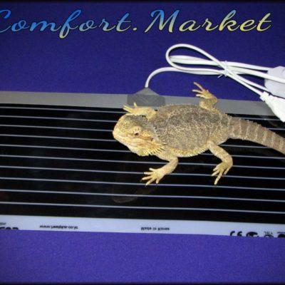 Теплый коврик для обогрева террариума с тропическими ящерицами